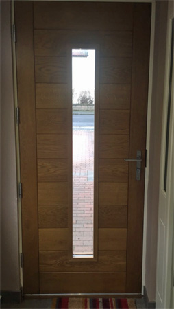 contemporary oak door with lever handles