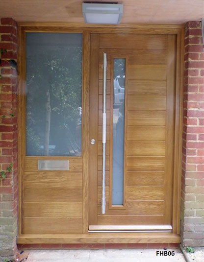contemporary oak door with part glazed side panel