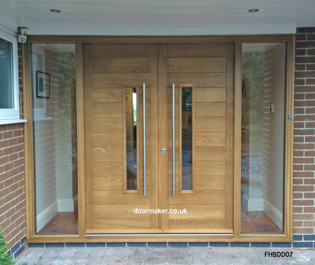 Contemporary front doors oak iroko and other woods for Modern front double door designs