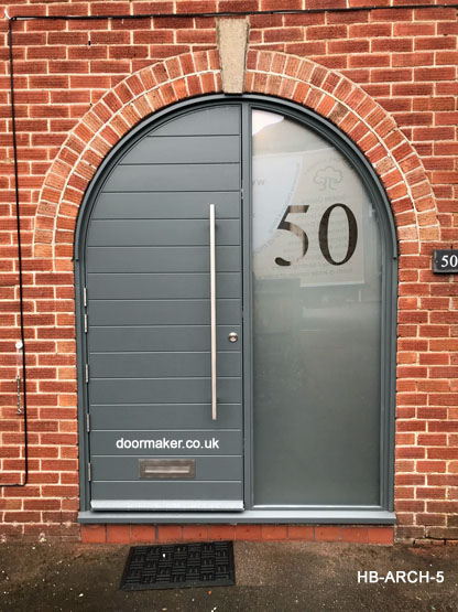 contemporary arched door and frame with sidelight