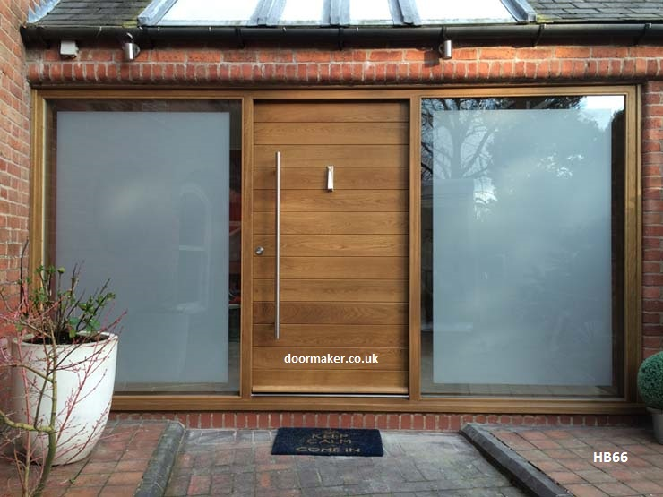 contemporary oak door and frame with wide sidelights